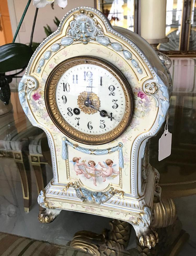 "German Royal Bonn Porcelain Mantle Clock with Time & Strike movement. Condition: Good, with no noticeable damage. Dimensions 10 1/4"" H x 7 1/2"" W x 4 3/4"" D."