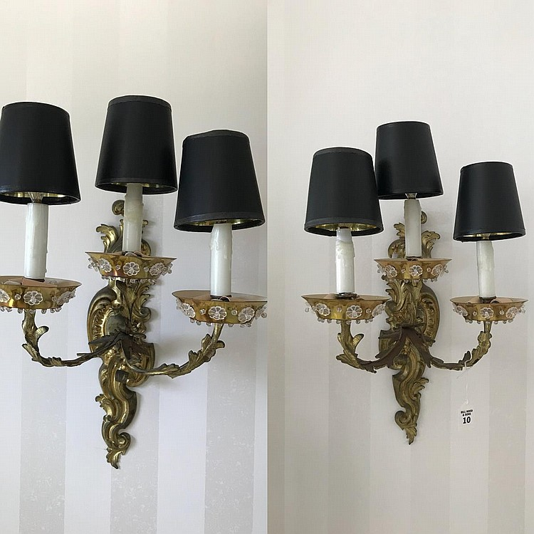"Pair of Gilt Bronze Three-Light Rococo-Style Sconces with brass ""wax catchers"" that feature applied glass flowers. Condition: Good and working. Dimensions: 23"" H x 13"" W x 11"" D."