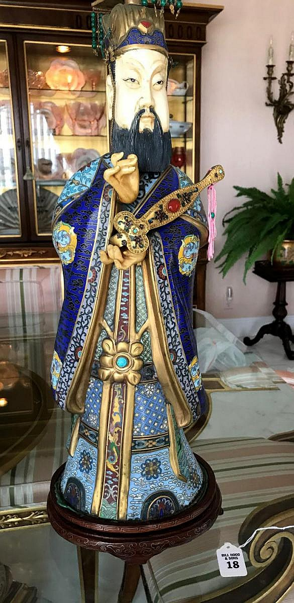 """Chinese Cloisonné & Bone Emperor Statue on a custom carved wood base. Intricate detailing on the figure's imperial robes. Holding Condition: Good, bone face has a small age crack above left eye. Dimensions: 24"""" H"""