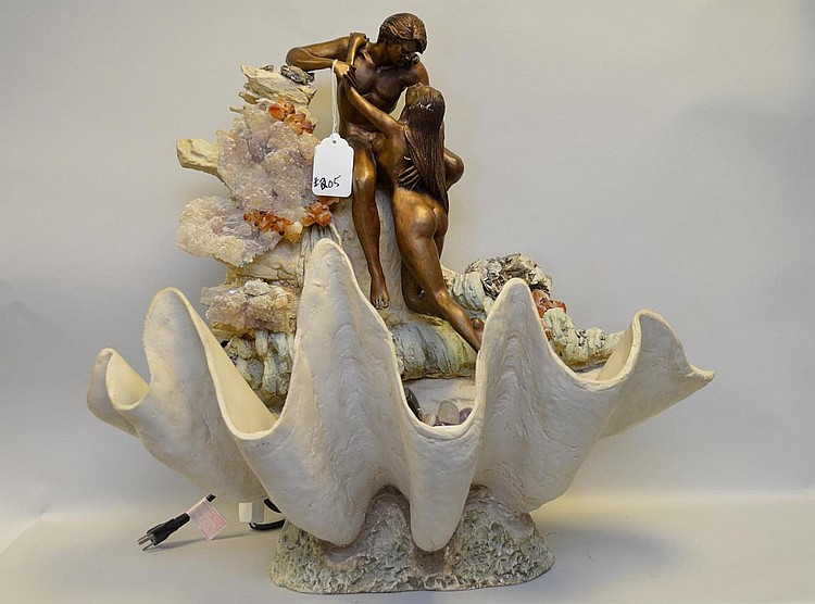 Manuel Vidal bronze Fountain sculpture of lovers on a rock in elaborate shell with hard stones to incl: tumbled stone of amethyst, quartz, aquamarine, citrine and more. Smokey quartz cluster, amethyst cluster and pyrite with abalone. Approx. 28 x 28