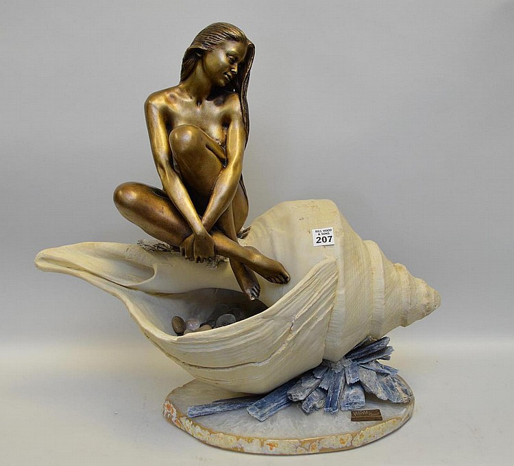 Manuel Vidal bronze sculpture on shell with tumbled stones with quartz base. 20 x 24 inches