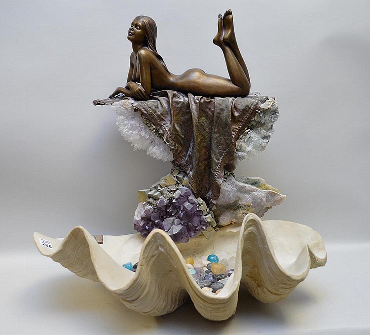 Manuel Vidal bronze sculpture reclining girl with quartz and tumbled stone, approx. 24 x 22 inches