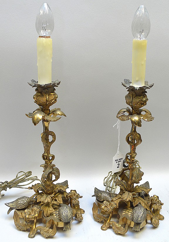 Pair of 19th Century Gilt Bronze Candlesticks. Ornate folate and bird decoration. Electrified and mounted as lamps. Condition: Good and working. Dimensions: Candlestick height- 11 1/4
