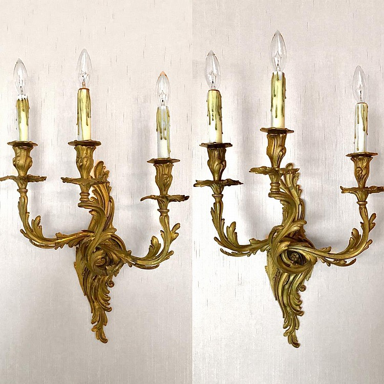 """Pair of Bronze Scroll Design Three-Light Rococo Style Sconces. Electrified. Condition: Good and working. Dimensions: 26"""" H x 15"""" W x 8"""" D"""