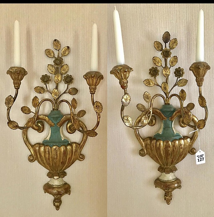 """Pair of Italian Carved Gilt Wood and Metal Two-Light Sconces Condition: Good, with minor normal wear. Dimensions: 23"""" H x 12"""" W x 4 1/2"""" D."""