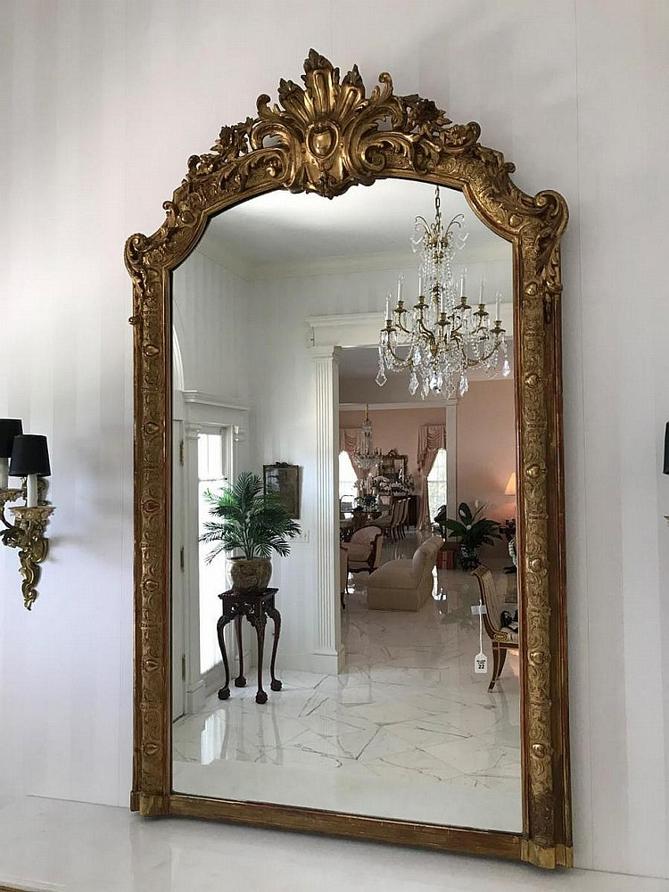 "Carved Italian Gilt Wood Rococo-Style Mirror Condition: A few small age cracks, but structure is sturdy. Dimensions: 58"" H x 38"" W."