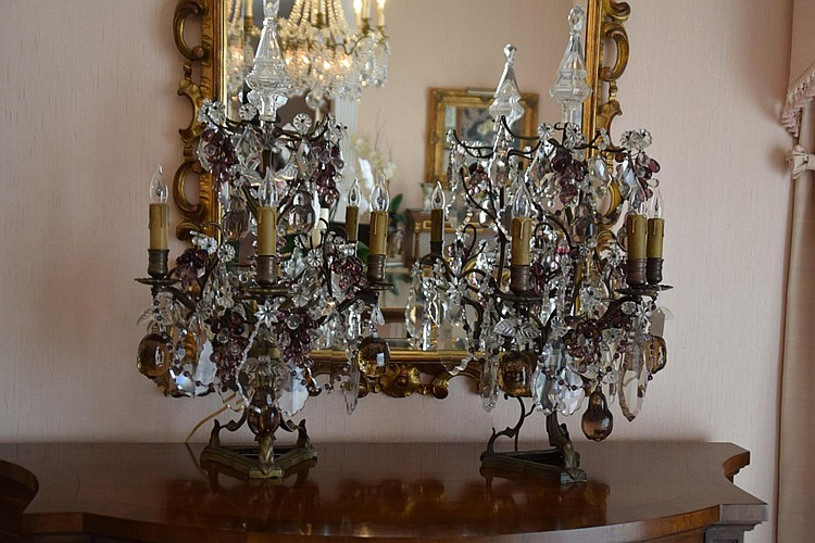 """Pair of Bronze & Glass Three-Light Girandoles - Amber & Amethyst glass fruit (grapes, pears, citrus), with clear crystal prisms, stars, and finials. Electrified. Condition: Good and working. Dimensions: 26"""" H x 14"""" W x 10"""" D."""