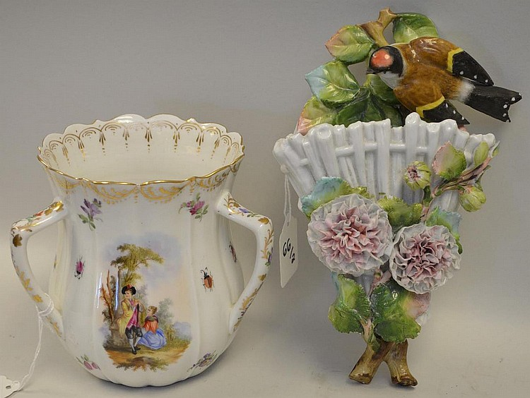 "Two Pieces of German Porcelain - One Loving Cup with Romantic Scenes Condition: Good, with normal wear. Dimensions: 5 1/4"" H. The other is a wall pocket with raised floral and bird decoration. Condition: Very slight losses to the flowers."
