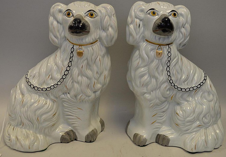 """Pair of Antique English Porcelain Staffordshire Dogs. Condition: Very slight paint loss. No cracks or chips. Dimensions: 9 1/2"""" H."""