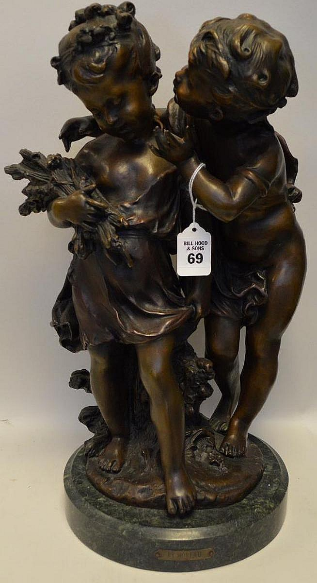 """Bronze Sculpture Depicting a Young Boy & Girl on a green marble base, sign A. Moreau. Condition: Good, with no noticeable damage. Dimensions: 18"""" H."""