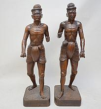 Pair Balinese carved wood figures on square wood base, 44