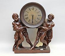 Carved wood 19th c. figural clock, 18
