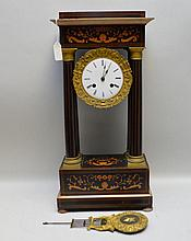 Antique Gilt Metal & Inlaid Wood Portico Clock, with time & strike movement. Four columns and shell, scroll & floral inlay design. Porcelain face with Roman numerals. Swinging hand has a star and harp design. Condition: Several losses to wood veneer.