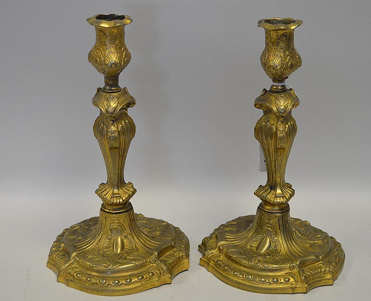 Pair 19th Century Gilt Bronze Candlesticks with scroll and shell decoration. Condition: good with minor normal wear. Ht. 9 7/8
