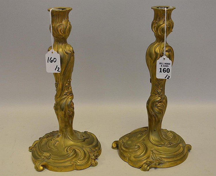 Pair of Antique French Gilt Bronze Candlesticks - Delicate foliate belle epoche design motif. Condition: Normal, expected wear from age and use. Some small areas of discoloration and minor scratches and nicks, also expected from use. Dimensions: 12