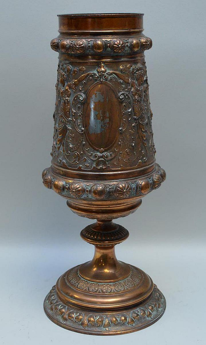 Ornate Copper Gilt Display Urn with Classical Imagery - Urn basin rotates on pedestal base and is covered with gorgeous classical detailing of elaborately dressed female muses/musicians. Condition: On plain oval medallion there is loss to the copper