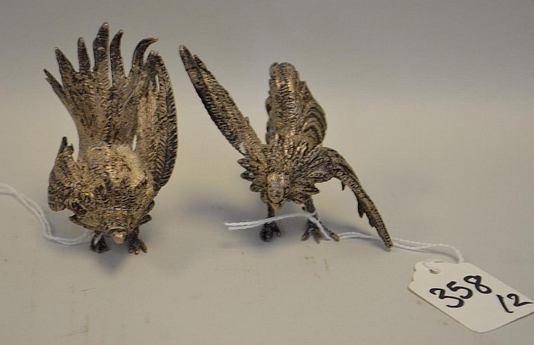 Two Sterling Silver Fighting Cocks Figurines - fighting roosters in two different poses. Each has a small plate with 925 and an unidentified makers mark. Condition: Good, with no noticeable damage. Dimensions: tail up - 3 1/2