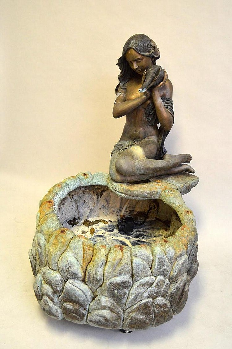 Bronze 2 part figural garden fountain, young girl holding a seashell seated at edge of circular stone motif base. 46 x 40 inches.