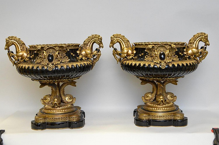 Pair of Ebony porcelain and bronze urns with heavily decorated bronze mounts, horse motif handles mounted on dolphin pedestal and graduated base 16 x 18 wide