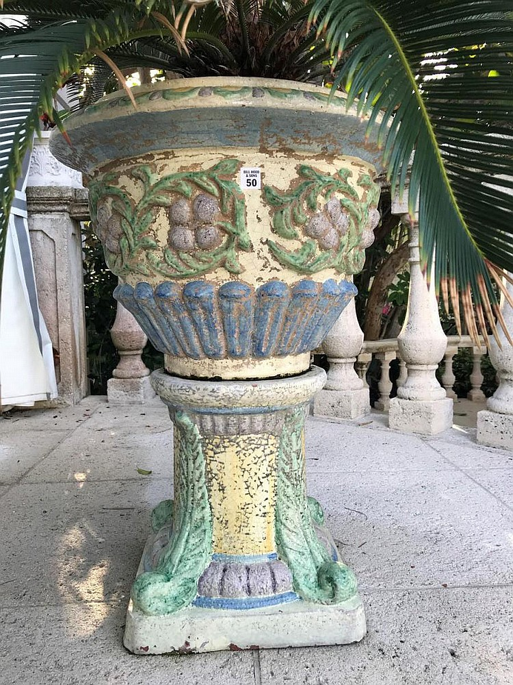 """Pair of Polychromed Glazed Terracotta Jardinières - Urn with pedestal base. Condition: Cracklature to glaze and wear consistent with outdoor use. Dimensions: 31"""" H x 22"""" diameter."""