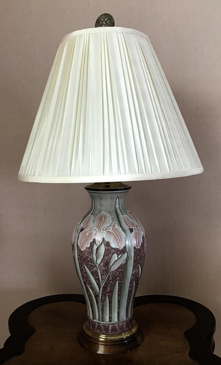 "Pair of Hand-Painted Porcelain Lamps with Mahogany Base. Features Irises. Condition: Good, with no noticeable damage. Dimensions: 24"" H from base to socket, overall height 38"" base to finial."