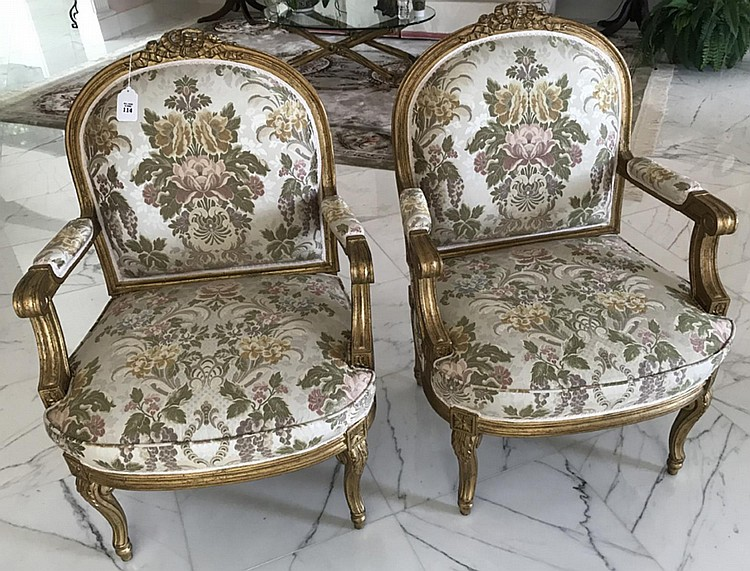 """Pair of French Carved Gilt Wood & Upholstered Arm Chairs - Condition: Good, with no noticeable damage. Dimensions: 39"""" H x 27"""" W x 22"""" D, seat height - 18""""."""