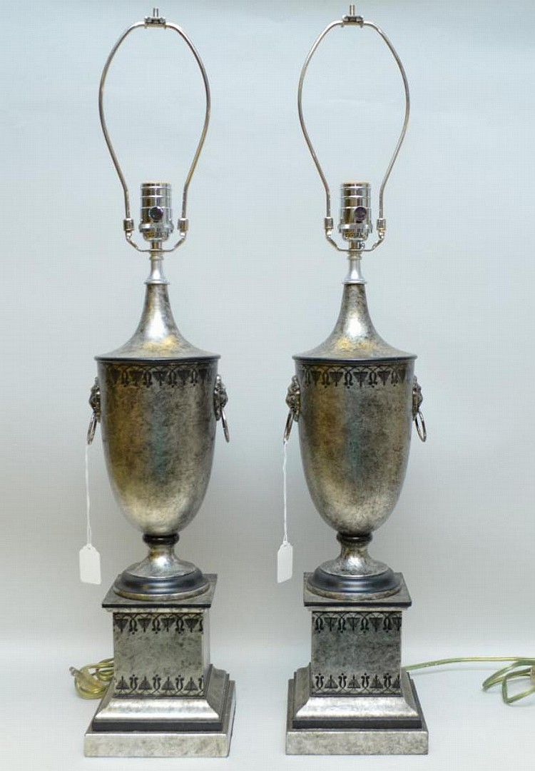 Pair of Silver & Black Painted Metal Urn Form Lamp, with lion and ring accent handles. Condition: Good and working with minor normal wear. Dimensions: 24