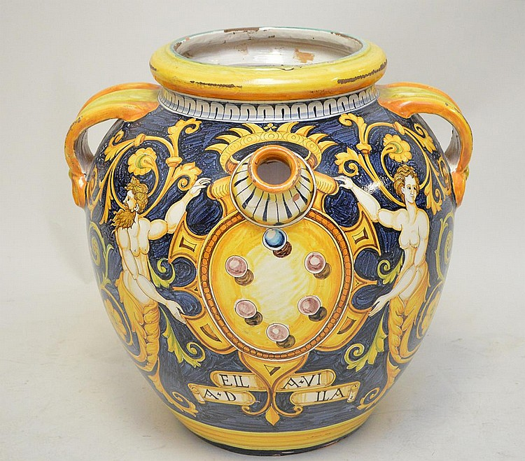 Large Polychrome Terracotta Classical Imagery Jar Planter - has two handles and a spout. Condition: Repairs to spout. Some loss and wear to glaze around top opening and rim. A crack runs from handle to body of jar on the right side, but is
