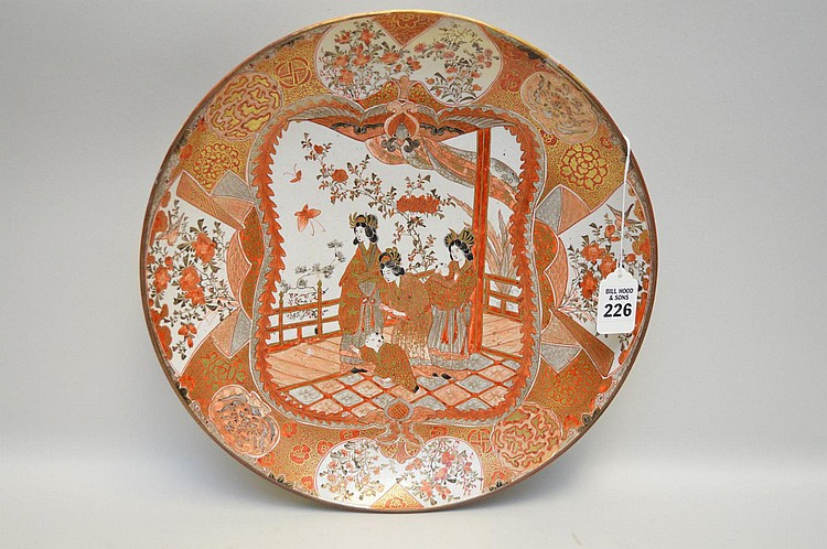 Japanese Kutani Geisha Figural Porcelain Charger - Ornate decoration on interior and hand-painted florals on exterior. Predominately reds and gilt coloring. Red painted six character mark on bottom. Condition: No cracks, chips, or repairs. Some