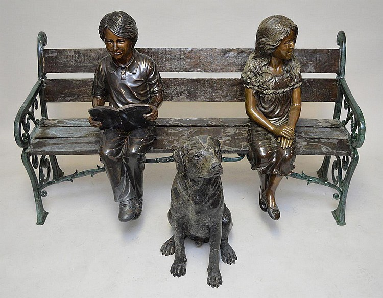 Bronze cast bench with girl and boy and their dog, bench is 62in long x 32in tall