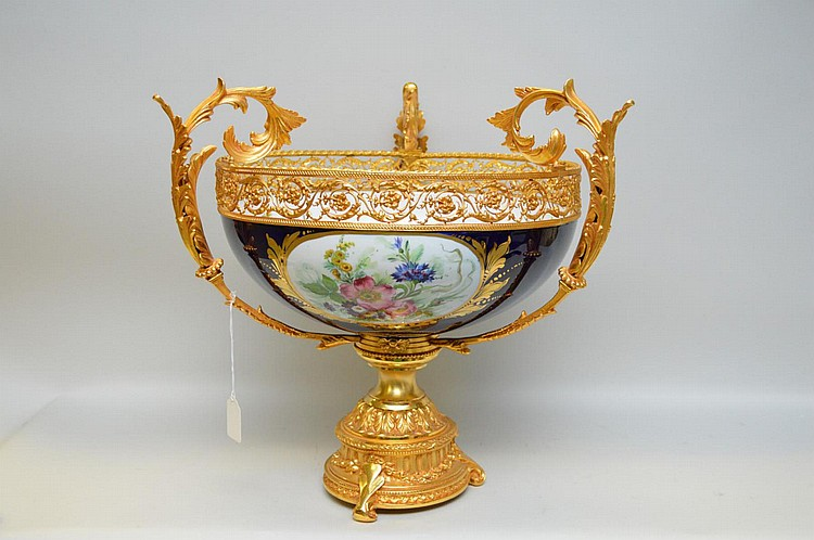 Italian Porcelain and Gilt Bronze Center Bowl - Features a dark blue exterior with three oval medallions with floral motifs, interior is white with florals. Ornate Florentine scroll motif gilt bronze, with a reticulated top. Condition: Good, with no