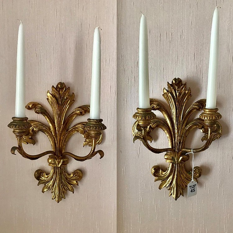 "Pair of Carved Gilt Wood Two-Light Candelabras. Condition: Good, with no noticeable damage. Dimensions: 13 1/2"" H"