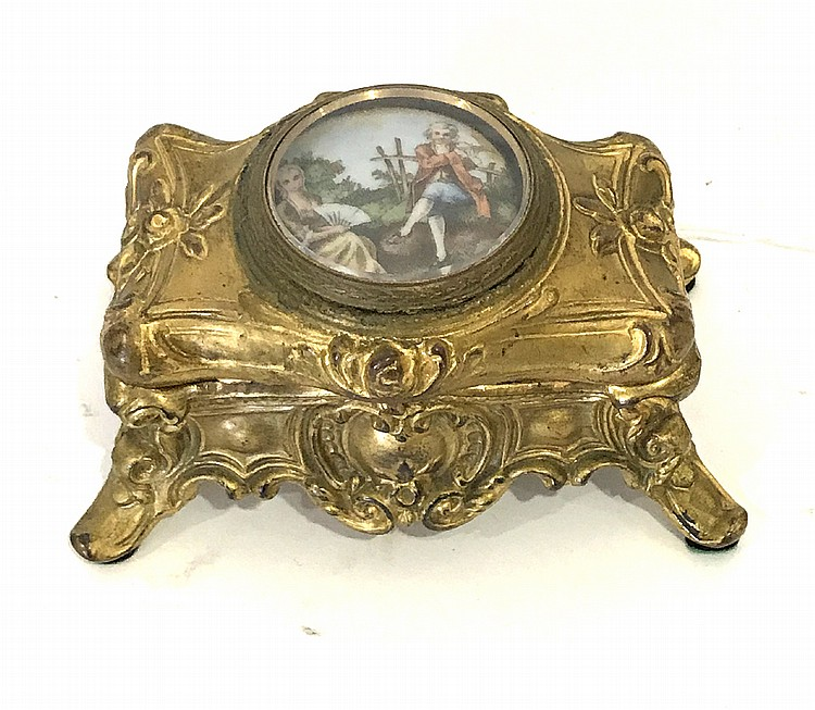 Antique French Gilt Metal Box Centered by a Porcelain Romantic Scene Condition: Good, with minor normal wear. Dimensions: 2 1/2