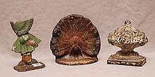 3 American antique doorstops, bouquet, peacocks and sunbonnet baby