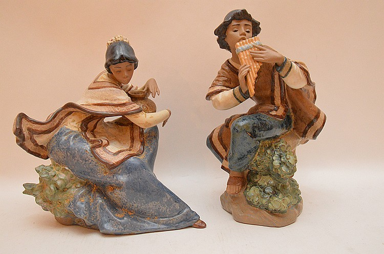 2 Lladro female figures, one playing instrument (11 1/4