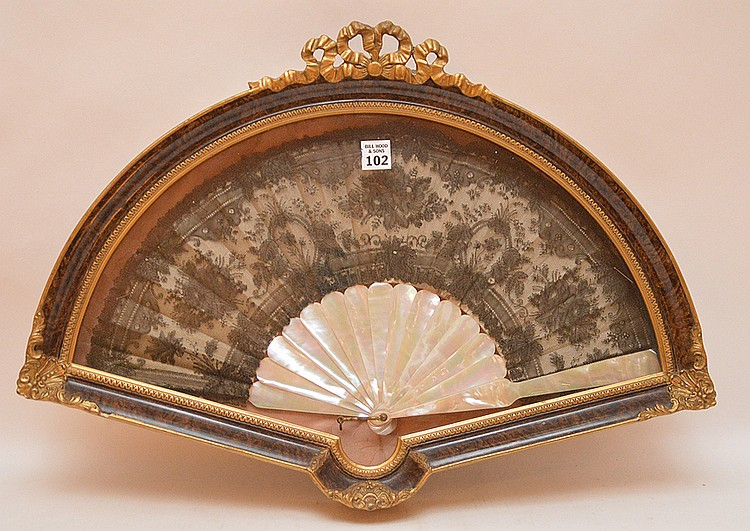 Antique fan in shadow box, 22