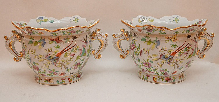 Pair of porcelain scalloped rim cache pots with fauna & flora design and gilded accents, 7 1/2