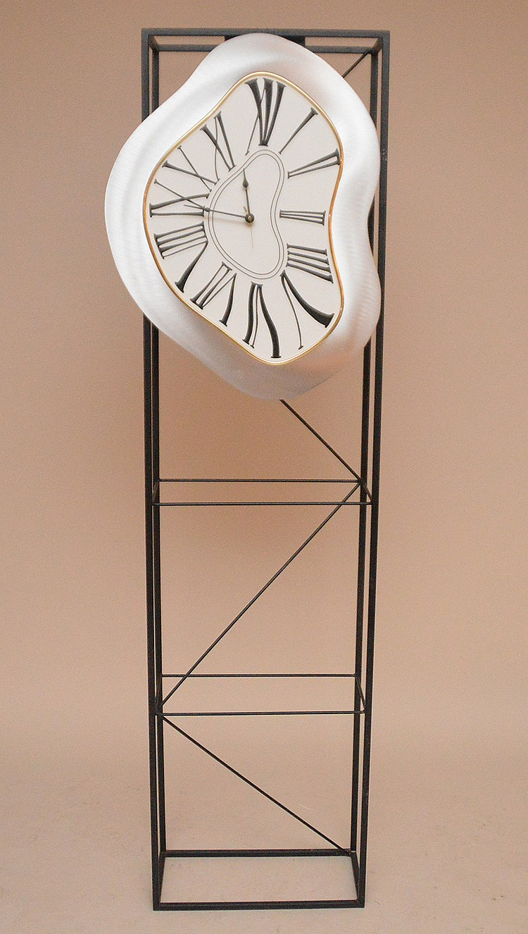 Modern style silvered wall clock mounted on black metal shelf, 76