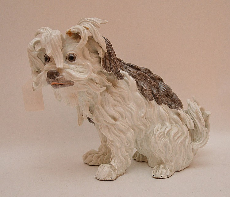 19th Century German Porcelain Dog.  Condition: right ear has been broke and re-glued.  Ht.  8 1/2
