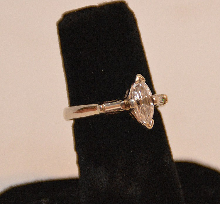 Ladies engagement ring, Marquis diamond with baguette on either side,.75/80pt,sI, h/I color, 14 kt white gold 4.0 grams