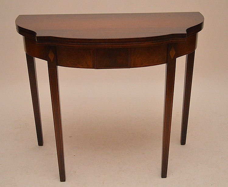 Mahogany card table with swing legs, shaped top, 29