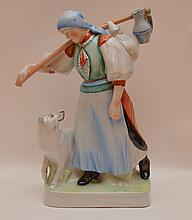 Zsolnay Porcelain Figure depicting a woman with a dog.  Ht 13