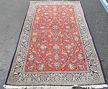 Handmade Persian Rug, 9' x 5' blues & reds