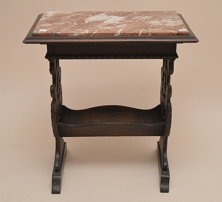Marble top trestle style end table with book rack beneath