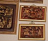 9 Chinese carved wall plaques, red with gilding