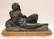Joseph Jules Emmanuel Cormier (Joe Descomps) French 1869-1950  Patinated Bronze Sculpture on a carved giltwood base.  Depicting a nude maiden.  Ht. 10 1/2