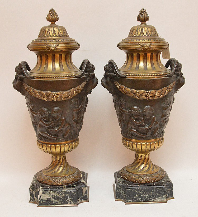 Pair Gilt & Patinaed Bronze Urns on marble bases. Ht. 18 1/2