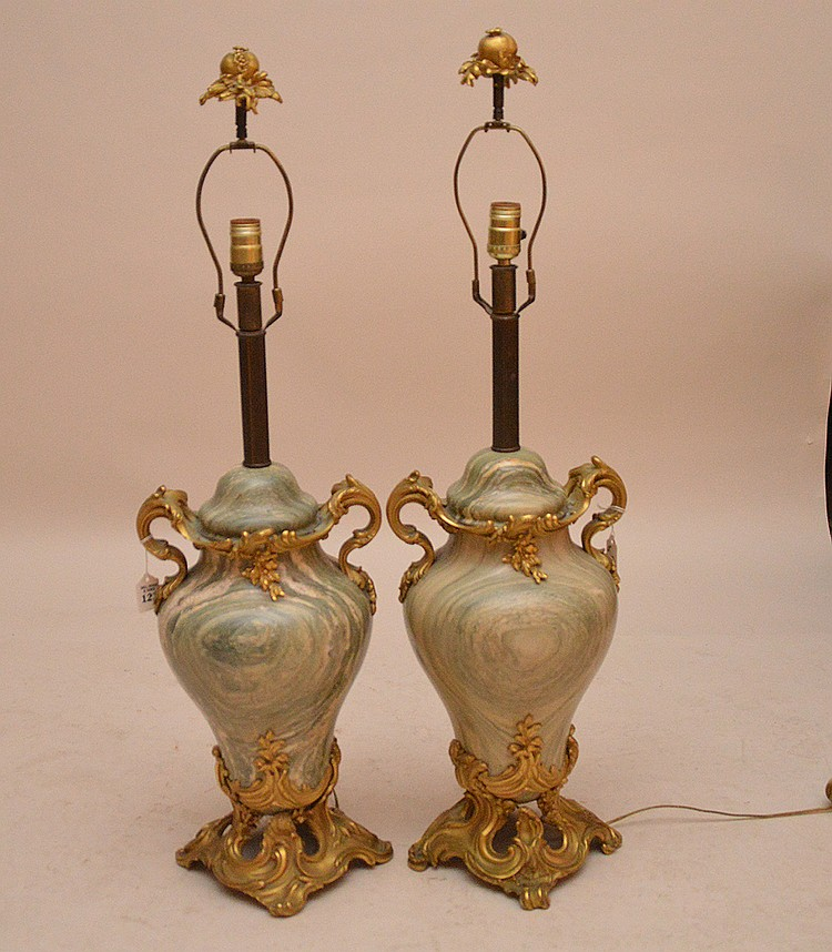Pair Gilt Bronze & Marble Urn Form Lamps. Each Marble Urn is enclosed by gilt bronze scroll decoration and has a gilt bronze finial. Urn Ht. 19