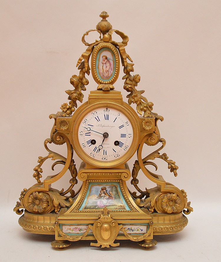 French Gilt Bronze & Porcelain Clock.  The enamel face Klaftenberger London.  The works are signed Klaftenberger Paris.  The clock has a time and strike movement.  Ht. 17