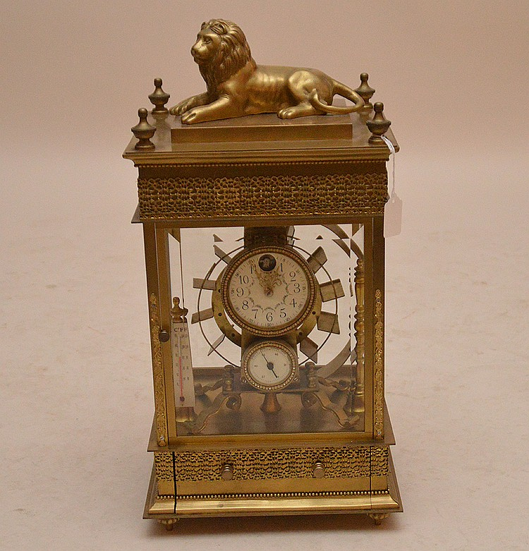 Bronze Clock With Ball Barring Mechanism and figural lion top.  The dial with jeweled rim.  Ht. 22